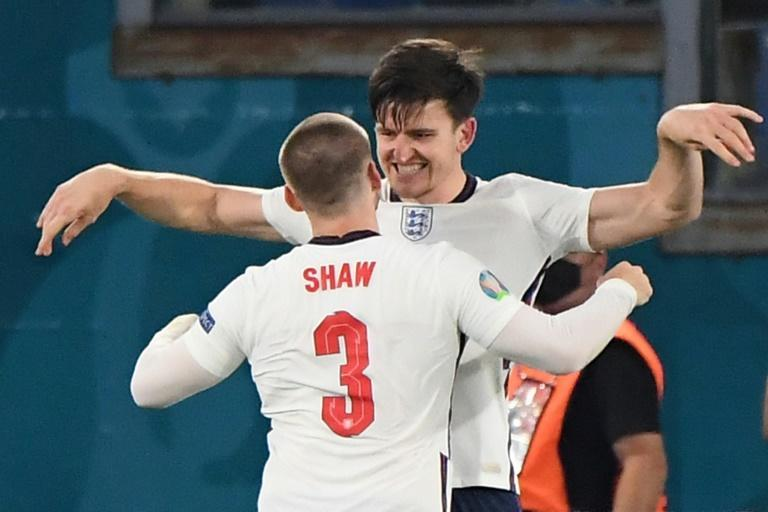 On my head son: Harry Maguire (top) was set up by Luke Shaw (bottom) for England's second goal against Ukraine