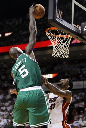 Boston Celtics' Kevin Garnett (5) dunks over Miami Heat's Udonis Haslem (40) during the second half of Game 5 in their NBA basketball Eastern Conference finals playoffs series against the Miami Heat, Tuesday, June 5, 2012, in Miami. (AP Photo/Lynne Sladky)