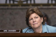FILE - In this May 7, 2020, file photo Sen. Jeanne Shaheen, D-NH, listens during a Senate Armed Services Committee hearing on Capitol Hill in Washington. At least 10 lawmakers and three congressional caucuses have ties to organizations that received federal coronavirus aid, according to government data released this week. A law firm owned by the husband of Shaheen, received money. (Kevin Dietsch/Pool via AP, File)