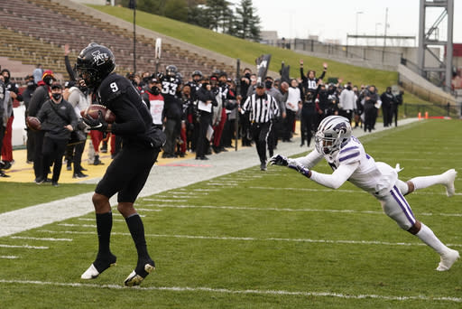 Iowa State wide receiver Joe Scates (9) catches a 33-yard touchdown pass ahead of Kansas State defensive back Justin Gardner, right, during the first half of an NCAA college football game, Saturday, Nov. 21, 2020, in Ames, Iowa. (AP Photo/Charlie Neibergall)