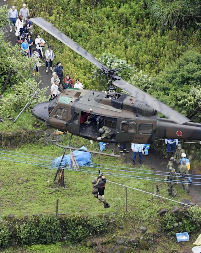 <p>A resident is airlifted for safety after a group of people are stranded in the Ono district following a huge landslide caused by heavy rain in Hita, Oita prefecture, southwestern Japan, Thursday, July 6, 2017. Troops worked Thursday to rescue hundreds of people stranded by flooding in southern Japan. (Photo: Nozomu Endo/Kyodo News via AP) </p>