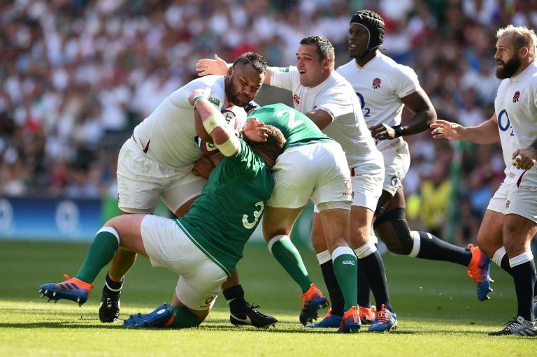 England's number 8 Billy Vunipola is tackled by Ireland's prop Tadhg Furlong