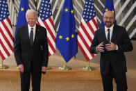 European Council President Charles Michel, right, and U.S. President Joe Biden speak with the media as they arrive for the EU-US summit at the European Council building in Brussels, Tuesday, June 15, 2021. (AP Photo/Francisco Seco)