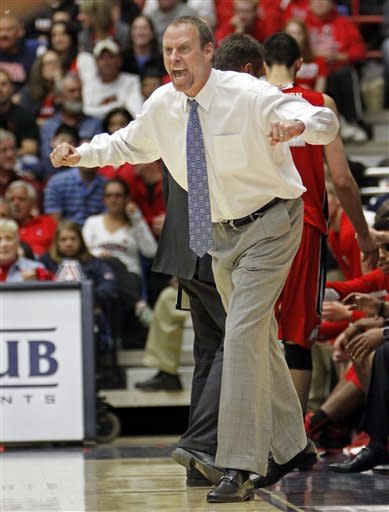 Utah's Larry Krystowiak reacts to a referee's call during the second half of an NCAA college basketball game against Arizona at McKale Center in Tucson, Ariz., Saturday, Jan. 5, 2013. Arizona won 60-57. (AP Photo/Wily Low)