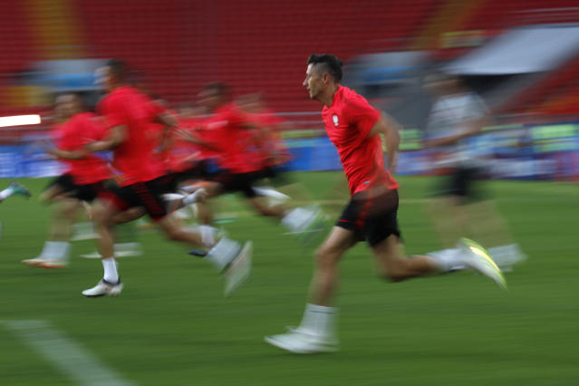 Poland's Robert Lewandowski runs during Poland's official training on the eve of the group H match between Poland and Senegal at the 2018 soccer World Cup in the Spartak Stadium in Moscow, Russia, Monday, June 18, 2018. (AP Photo/Hassan Ammar)