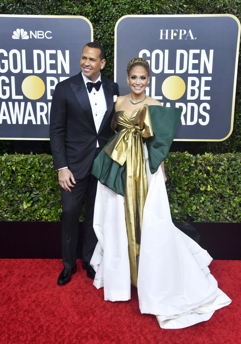 Alex Rodriguez and Jennifer Lopez pose on the 2020 Golden Globes red carpet.