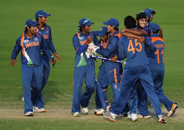 TOWNSVILLE, AUSTRALIA - AUGUST 23:  The Indian team celebrate after winning  the ICC U19 Cricket World Cup 2012 Semi Final match between India and New Zealand at Tony Ireland Stadium on August 23, 2012 in Townsville, Australia.  (Photo by Ian Hitchcock/Getty Images)