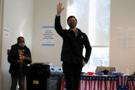 Democratic U.S. Senate challenger from Georgia Jon Ossoff waves after voting early in Atlanta on Tuesday, Dec. 22, 2020. (AP Photo/John Bazemore)