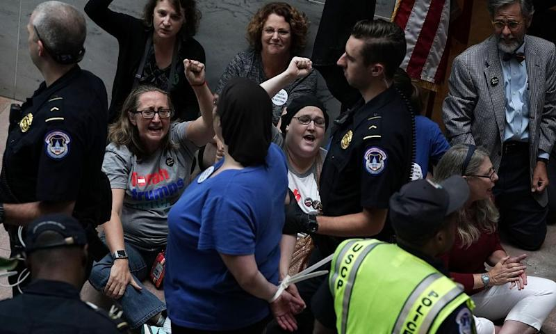 Activists chant slogans during a protest outside the office of the Senate judiciary committee chairman Chuck Grassley.