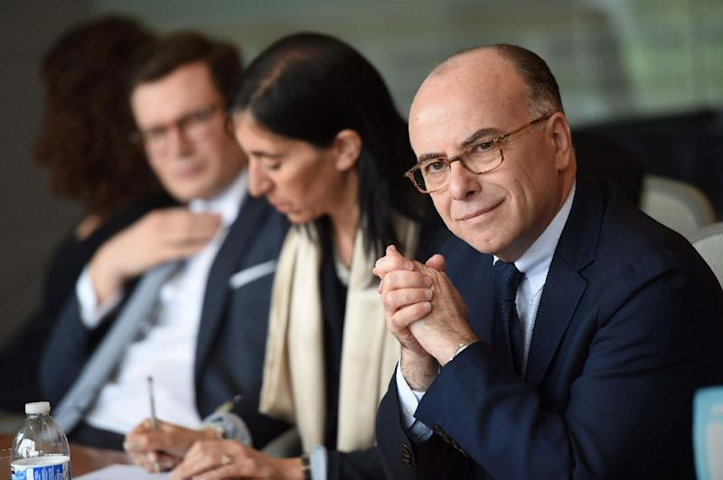 French Interior Minister Bernard Cazeneuve (R) meets with executives at Google in Mountain View, California, on February 20, 2015 (AFP Photo/Susana Bates)