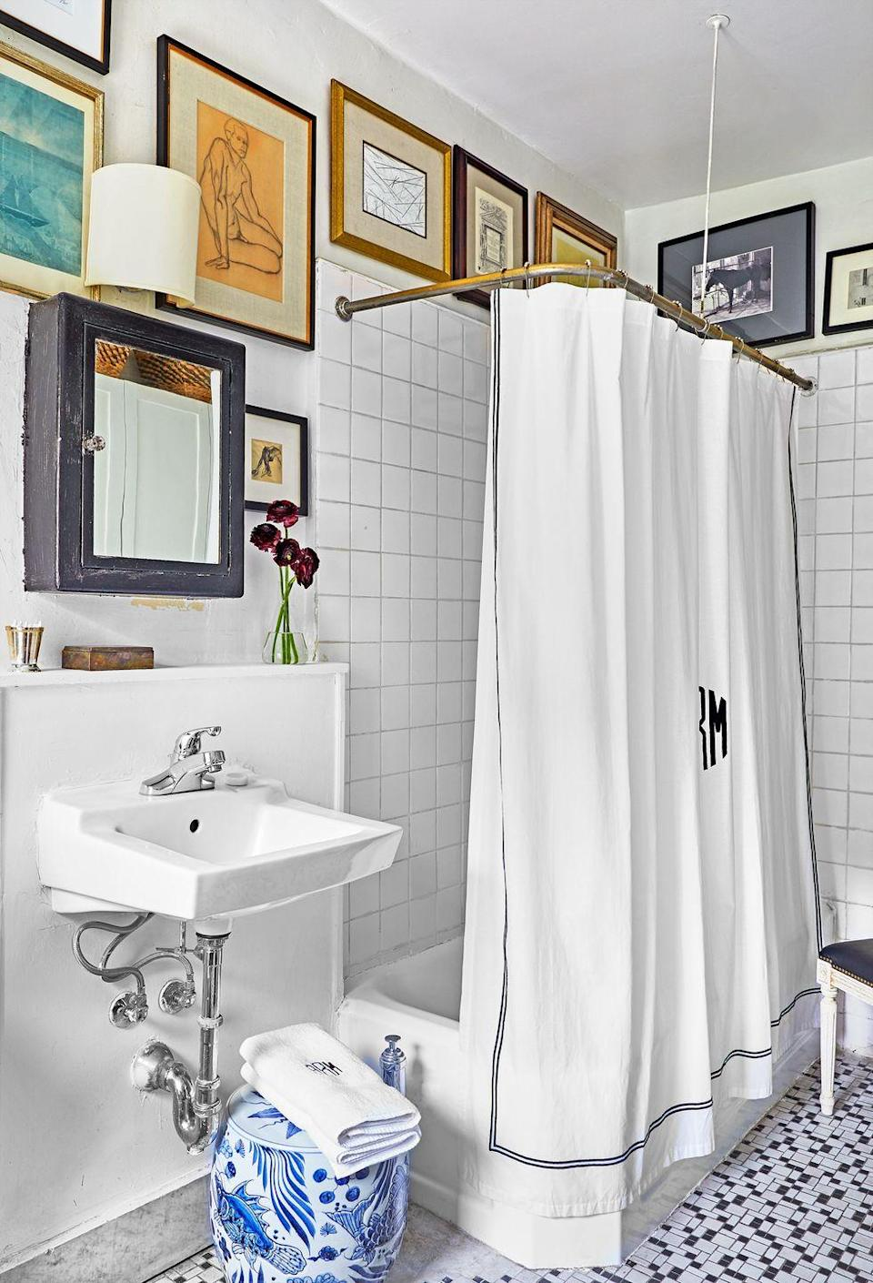 <p>Sure, it might not be the first thing that comes to mind when you think bathroom decor, but what else are you going to do with that otherwise-unused space above your shower? Designer Alexander Reid shows how it adds some much-needed texture to an all-white bathroom (P.S. This is a great design choice for rentals!). </p>