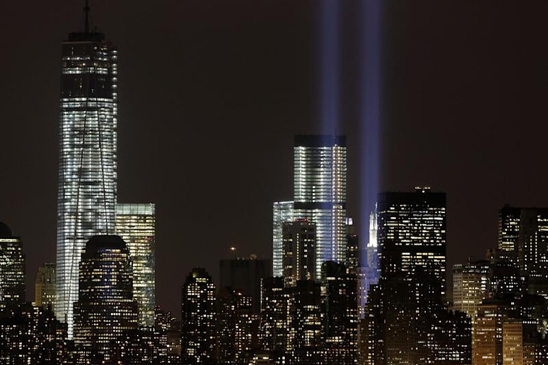 The Tribute in Light rises above the lower Manhattan skyline and Four World Trade Center, center, and One World Trade Center, left, in a test of the memorial light display, Monday, Sept. 9, 2013 in New York. The twin beams of light will also appear Wednesday, Sept. 11, twelve years after the terrorist attacks of Sept. 11, 2001. (AP Photo/Mark Lennihan)