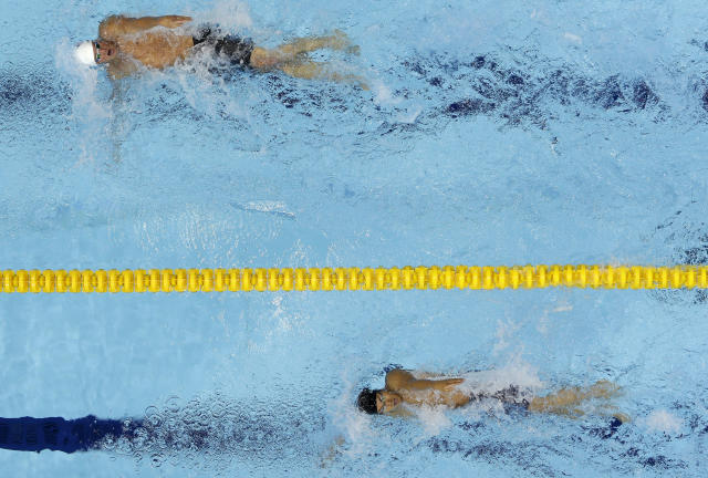 Unites States' Ryan Lochte leads Japan's Yuya Horihata in a heat of the men's 400-meter individual medley at the Aquatics Centre in the Olympic Park during the 2012 Summer Olympics in London, Saturday, July 28, 2012. (AP Photo/Mark Duncan)