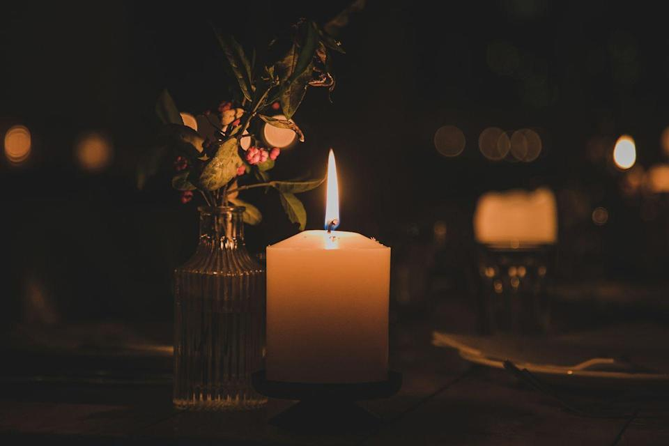 """<p>Set a super romantic mood by shutting off all the lights for the evening and doing everything by candlelight. Cell phone flashlights aren't allowed either!</p><p><a class=""""link rapid-noclick-resp"""" href=""""https://www.amazon.com/SRG-Ivory-Unscented-Votive-Candles/dp/B00WV2W5NU/?tag=syn-yahoo-20&ascsubtag=%5Bartid%7C10050.g.30445302%5Bsrc%7Cyahoo-us"""" rel=""""nofollow noopener"""" target=""""_blank"""" data-ylk=""""slk:SHOP CANDLES"""">SHOP CANDLES</a></p>"""