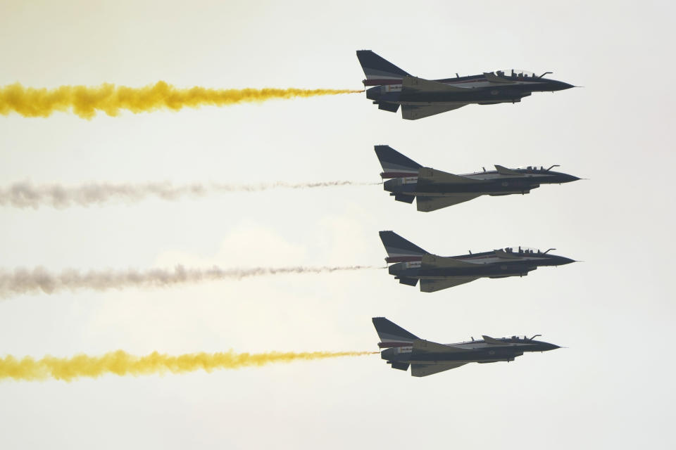 """Members of the """"August 1st"""" Aerobatic Team of the Chinese People's Liberation Army (PLA) Air Force perform during the 13th China International Aviation and Aerospace Exhibition, also known as Airshow China 2021, on Tuesday, Sept. 28, 2021 in Zhuhai in southern China's Guangdong province. (AP Photo/Ng Han Guan)"""
