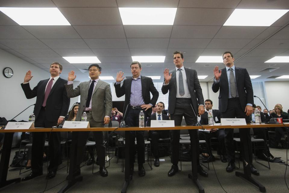 Venture Capitalists and Bitcoin investors (L-R) Barry Silbert, Jeremy Liew, Fred Wilson, Cameron Winklevoss and Tyler Winklevoss are sworn in before speaking at a New York State Department of Financial Services (DFS) virtual currency hearing in the Manhattan borough of New York January 28, 2014. REUTERS/Lucas Jackson
