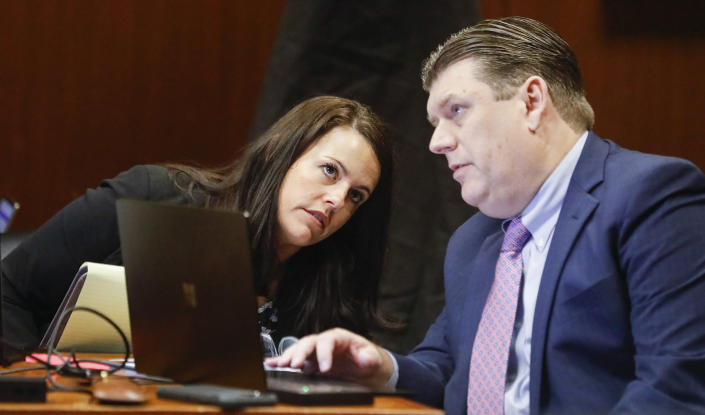Defense attorneys Jennifer Frese, left, and Chad Frese talk as Chad Frese cross examines Mollie Tibbetts' boyfriend Dalton Jack during the trial of Cristhian Bahena Rivera at the Scott County Courthouse in Davenport, Iowa, on Wednesday, May 19, 2021. Rivera is charged with first-degree murder in the death of Tibbetts. (Jim Slosiarek/The Gazette via AP, Pool)