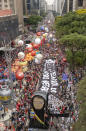 Demonstrators rally alongside a large inflatable doll depicting Brazilian President Jair Bolsonaro as the Grim Reaper, during a protest against him, calling for his impeachment over his government handling of the pandemic and accusations of corruption in the purchases of COVID-19 vaccines in Sao Paulo, Brazil, Saturday, Oct. 2, 2021. (AP Photo/Andre Penner)