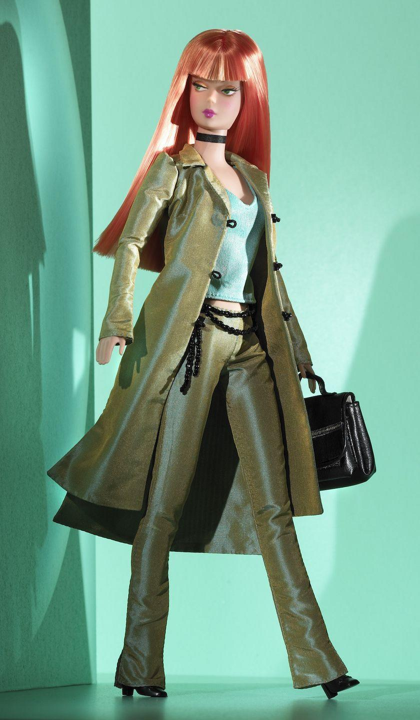 <p>Producer Barbie is all edge, with a dramatic 'do and an olive-hued outfit that means business. </p>