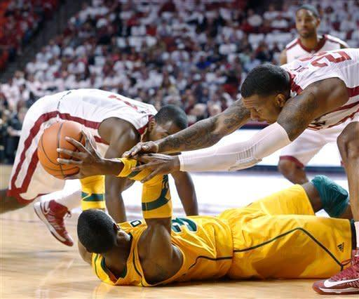 Oklahoma forward Romero Osby (24) reaches in to take the ball away from Baylor forward Cory Jefferson during the first half of an NCAA college basketball game in Norman, Okla., Saturday, Feb. 23, 2013. Oklahoma guard Sam Grooms is at left. (AP Photo/Sue Ogrocki)