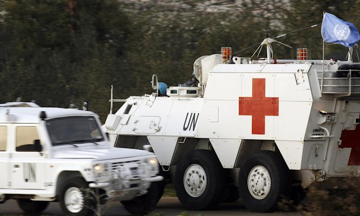 Spanish UNIFIL soldiers drive an armoured emergency vehicle in in Abbassiyeh, Lebanon after picking up the body of a Spanish peacekeeper who was killed on January 28, 2015 (AFP Photo/Mahmoud Zayyat)