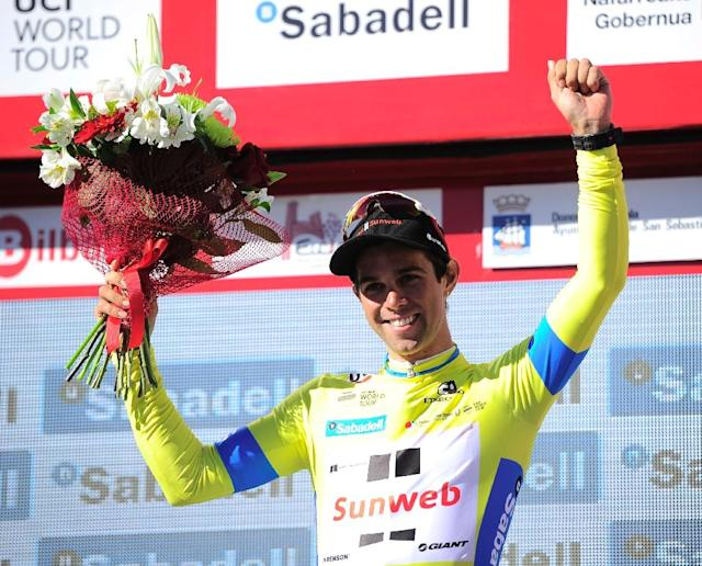 Team Sunweb's Australian rider Michael Matthews celebrates his yellow jersey on the podium after winning the first stage of the 2017 Tour of the Basque country (Vuelta Ciclista al Pais Vasco)on April 3, 2017 (AFP Photo/ANDER GILLENEA)
