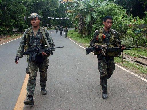 Philippine marines patrol a highway on Basilan island in 2010