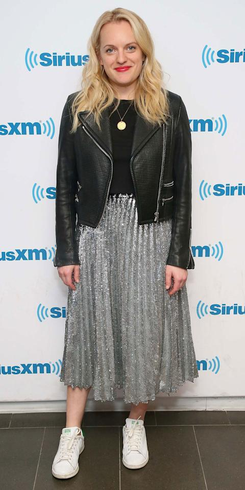 <p>While visiting SiriusXM Studios in NYC, Elisabeth Moss balanced out her metallic midi skirt with some classic wardrobe staples, including a black leather jacket, a black tee, and some Adidas Stan Smith sneakers.</p>