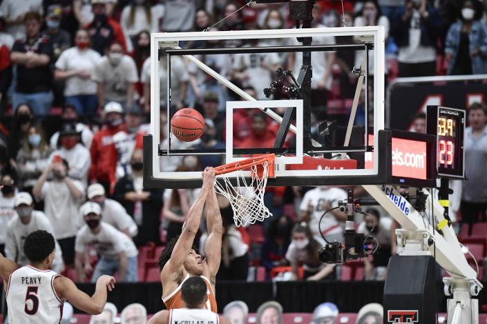 Texas' Jericho Sims (20) misses a dunk during the second half of an NCAA college basketball game against Texas Tech in Lubbock, Texas, Saturday, Feb. 27, 2021. (AP Photo/Justin Rex)