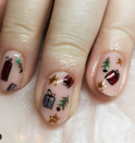 "<p>Can't decide between trees, presents, stars or other fun nail art for Christmas? Do as <a href=""https://www.instagram.com/polishedbybecky/"" rel=""nofollow noopener"" target=""_blank"" data-ylk=""slk:nail artist Rebecca Morrissey"" class=""link rapid-noclick-resp"">nail artist Rebecca Morrissey</a> did and add all your favorites on one nail with the help of a pack of nail stickers.</p><p><a class=""link rapid-noclick-resp"" href=""https://www.amazon.com/dp/B08B5WMJYF/ref=sspa_dk_hqp_detail_aax_0?tag=syn-yahoo-20&ascsubtag=%5Bartid%7C10072.g.34113691%5Bsrc%7Cyahoo-us"" rel=""nofollow noopener"" target=""_blank"" data-ylk=""slk:SHOP NAIL STICKERS"">SHOP NAIL STICKERS</a></p>"