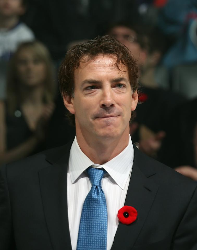 TORONTO, ON - NOVEMBER 11: Joe Sakic is presented with his Hall of Fame jacket prior to the Hockey Hall of Fame Legends Game at the Air Canada Centre on November 11, 2012 in Toronto, Canada. Sakic will be inducted into the Hockey Hall of Fame at a ceremony at the Hall on November 12.  (Photo by Bruce Bennett/Getty Images)