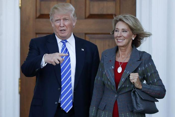 President-elect Donald Trump and Betsy DeVos after a meeting last weekend in Bedminster, N.J. (Photo: Carolyn Kaster/AP)