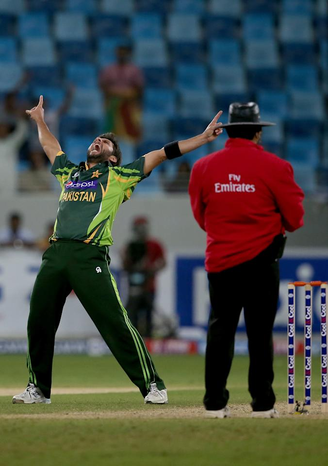 DUBAI, UNITED ARAB EMIRATES - DECEMBER 20:  Sahid Afridi of Pakistan celebrates after dismissing Nuwan Kulasekara of Sri Lanka during the second One-Day International (ODI ) match between Sri Lanka and Pakistan at the Dubai Sports City Cricket Stadium on December 20, 2013 in Dubai, United Arab Emirates.  (Photo by Francois Nel/Getty Images)