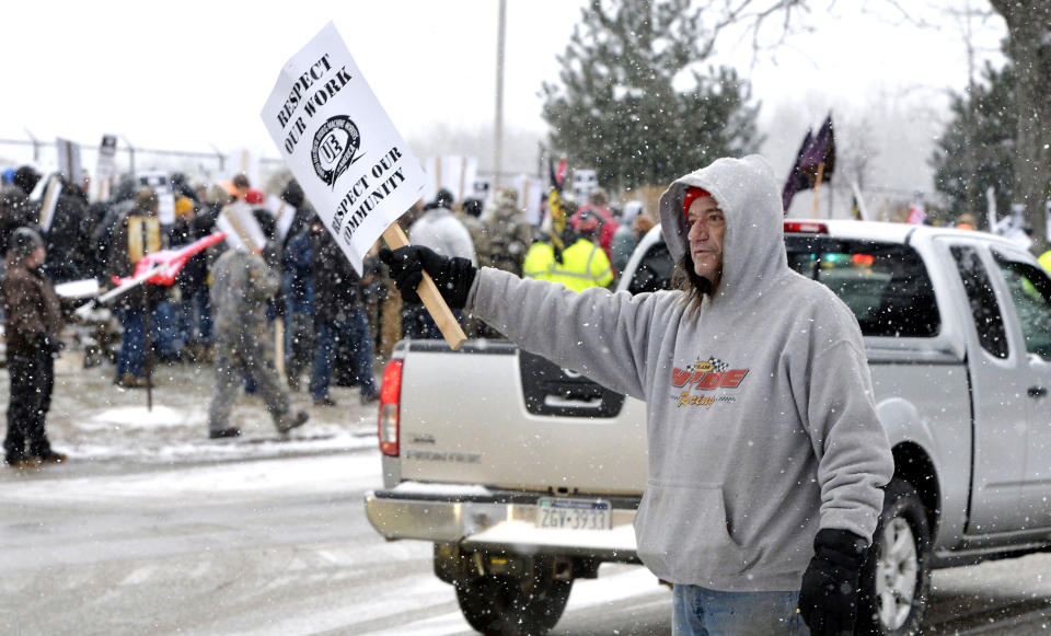 Wabtec Corp. employee Morris Hyde, who is a members of UE Local 506, joins strikers near the west gate of the former GE Transportation plant in Lawrence Park Township, Erie County, Pa., on Tuesday, Feb. 26, 2019. The merger between GE Transportation and Wabtec Corp., also known as Westinghouse Air Brake Technology Corp., based in Wilmerding, Allegheny County, Pa., was finalized on Feb. 25 but a labor agreement was not reached between Wabtech and several unions, including more than 1,000 UE Local 506 members at the Erie-area manufacturing plant. (Greg Wohlford/Erie Times-News via AP)