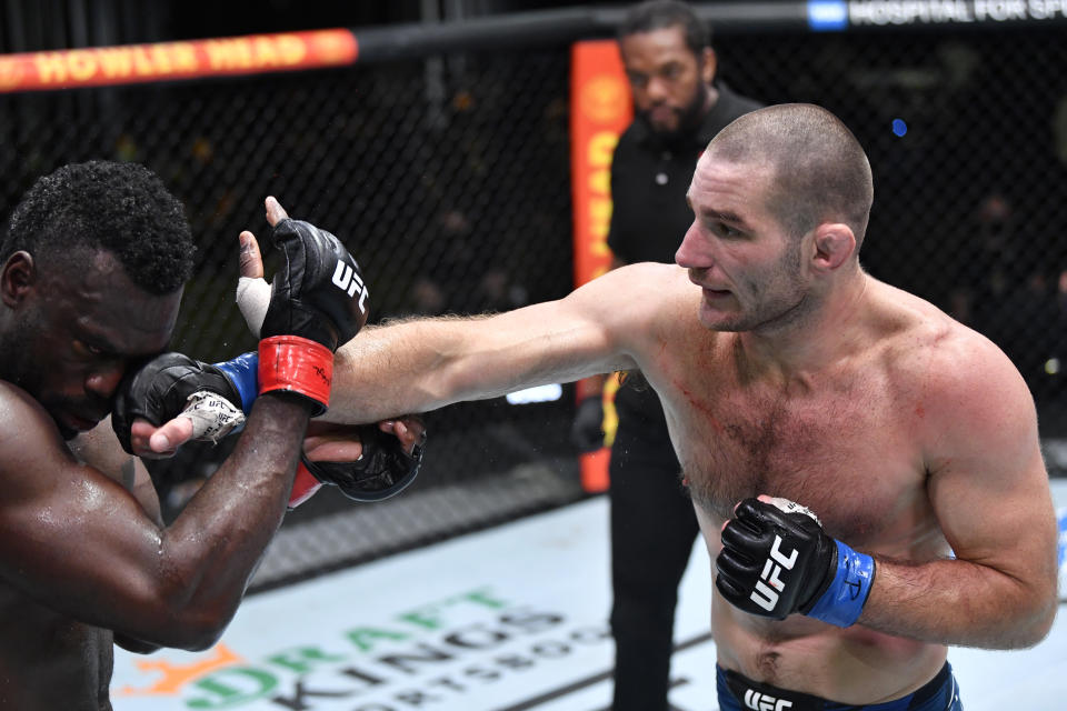 LAS VEGAS, NEVADA - JULY 31: (R-L) Sean Strickland punches Uriah Hall of Jamaica in a middleweight fight during the UFC Fight Night event at UFC APEX on July 31, 2021 in Las Vegas, Nevada. (Photo by Chris Unger/Zuffa LLC)