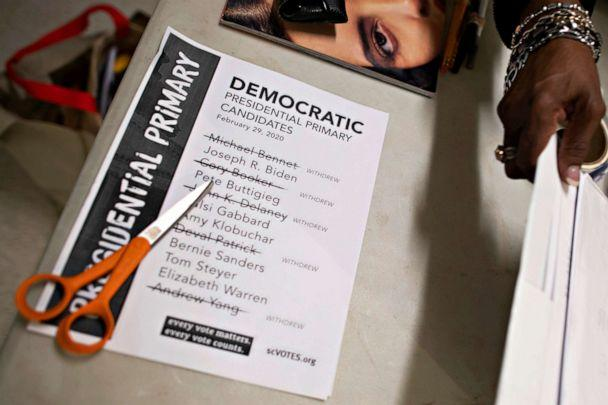 PHOTO: Scissors rest atop a notice alerting voters as to the remaining Democratic presidential primary candidates on the day of the South Carolina primary at a polling location, in Spartanburg, S.C., Feb. 29, 2020. (Mark Makela/Reuters)
