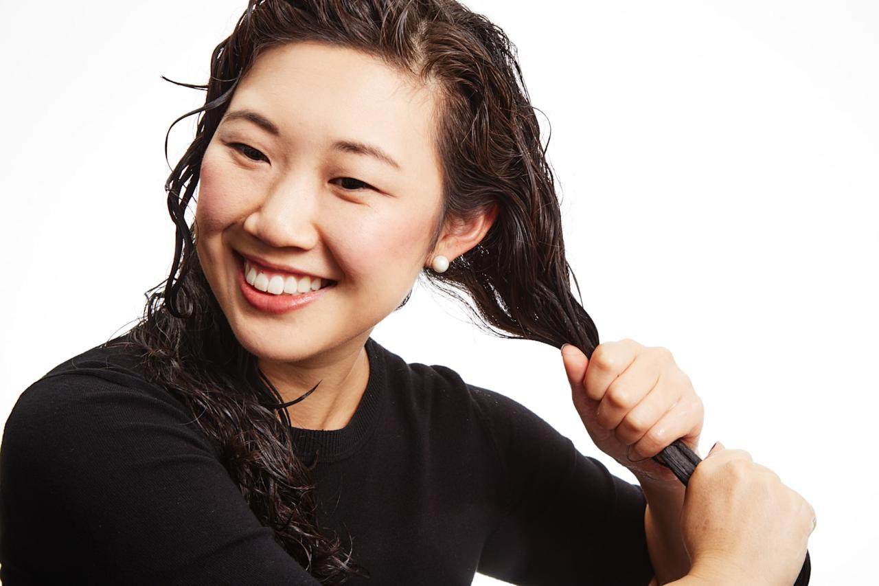 """<p>We know it's tempting to rake conditioner through your freshly shampooed hair, but the right way to apply moisturizer to your curls is a press and smooth strategy. Squeeze the conditioner from midshaft to ends. Then, run your fingers through to detangle. """"The cuticle for curly hair isn't a smooth cuticle, so you have to smooth it in yourself,"""" said Eladia. Once the product is distributed, rinse with cool water to close the hair cuticle completely and lock in the moisture.</p>"""