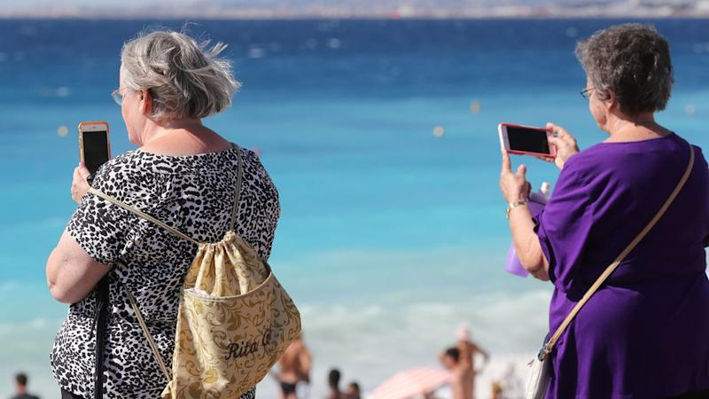 Two women using their mobile phones in France