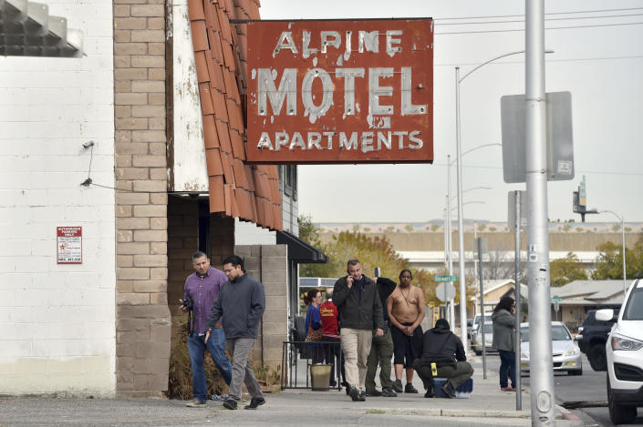 Investigators work the scene of a fire at a three-story apartment complex early Saturday, Dec. 21, 2019 in Las Vegas. The fire was in first-floor unit of the Alpine Motel Apartments and its cause was under investigation, the department said. Authorities say multiple fatalities were reported and many more were injured. (AP Photo/David Becker)