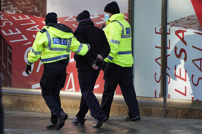 An anti-lockdown protester is detained in Newcastle city centre. Priti Patel has praised the 'selflessness' of officers policing through the pandemic (Getty Images)