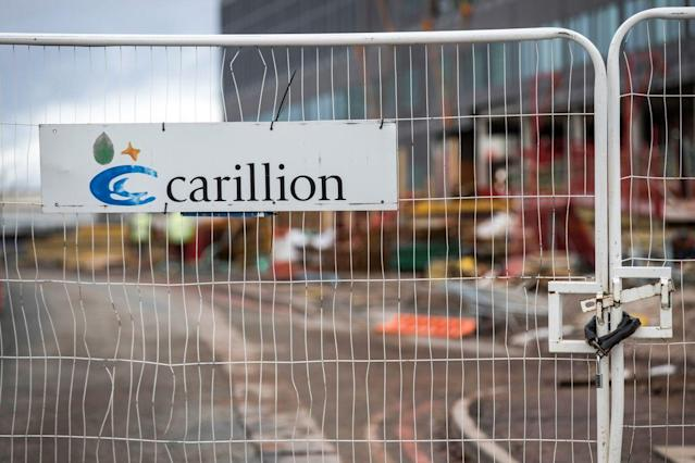 A padlock sits on fencing surrounding the Midland Metropolitan Hospital construction site, operated by Carillion Plc, in Smethwick, U.K., on Thursday, Jan. 18, 2018. Photographer: James Beck/Bloomberg