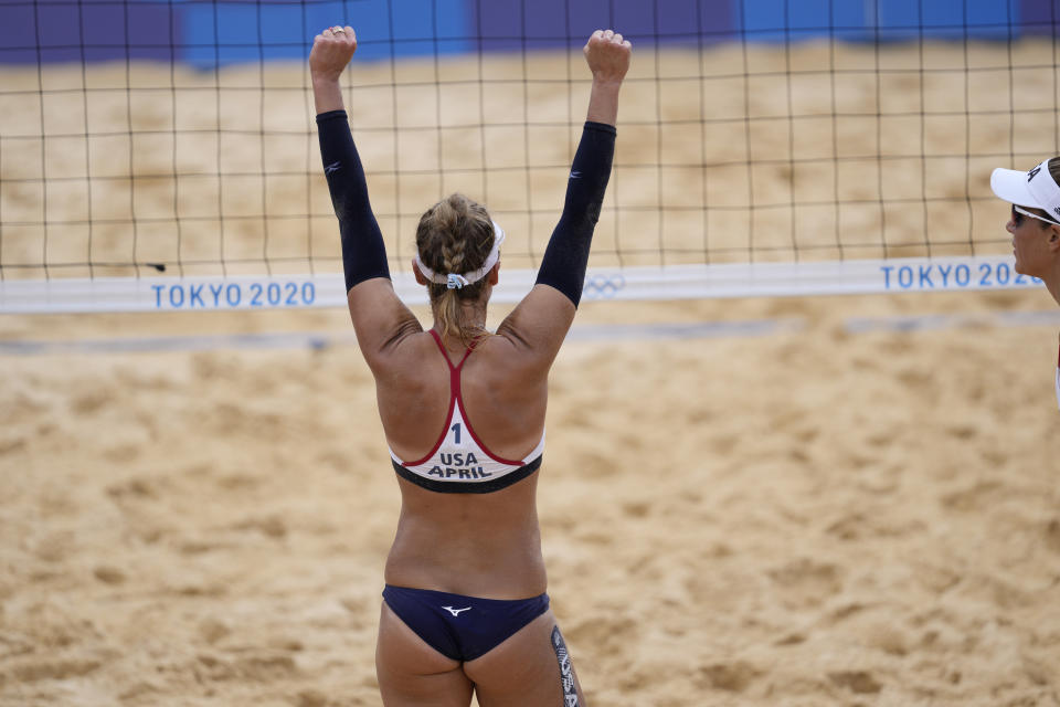April Ross, of the United States, celebrates winning a women's beach volleyball match against Germany at the 2020 Summer Olympics, Tuesday, Aug. 3, 2021, in Tokyo, Japan. (AP Photo/Petros Giannakouris)