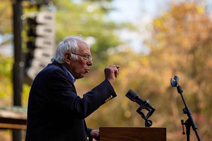 Sen. Bernie Sanders (I-Vt.) campaigns for Joe Biden, then the Democratic presidential nominee, in Lebanon, N.H., Oct. 3, 2020. (Elizabeth Frantz/The New York Times)