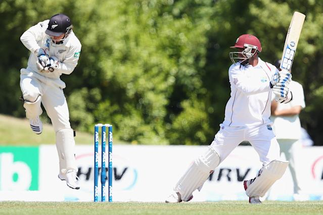 DUNEDIN, NEW ZEALAND - DECEMBER 05: Denesh Ramdin of the West Indies cuts the ball away for four runs during day three of the first test match between New Zealand and the West Indies at University Oval on December 5, 2013 in Dunedin, New Zealand. (Photo by Hannah Johnston/Getty Images)