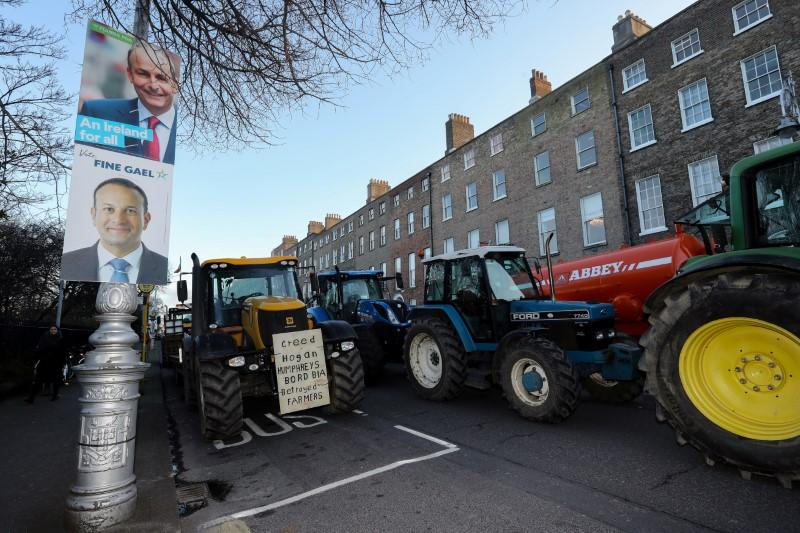 Election posters are seen during farmers' protest near Government Buildings in Dublin