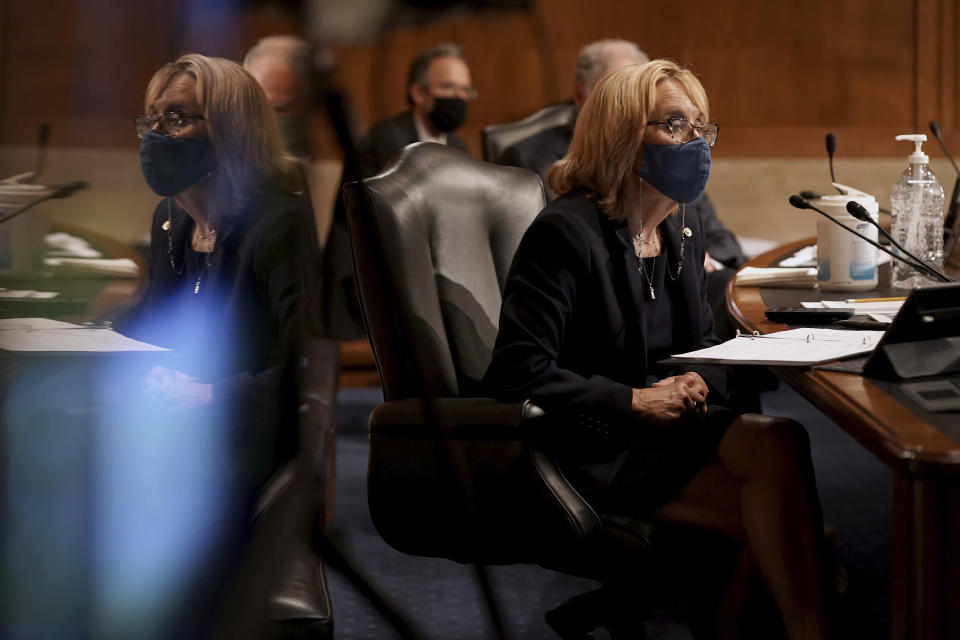 Sen. Maggie Hassan, D-N.H., listens to Surgeon General Jerome Adams give an opening statement during a Senate Health, Education, Labor and Pensions Committee hearing to discuss vaccines and protecting public health during the coronavirus pandemic on Capitol Hill, Wednesday, Sept. 9, 2020, in Washington. (Greg Nash/Pool via AP)