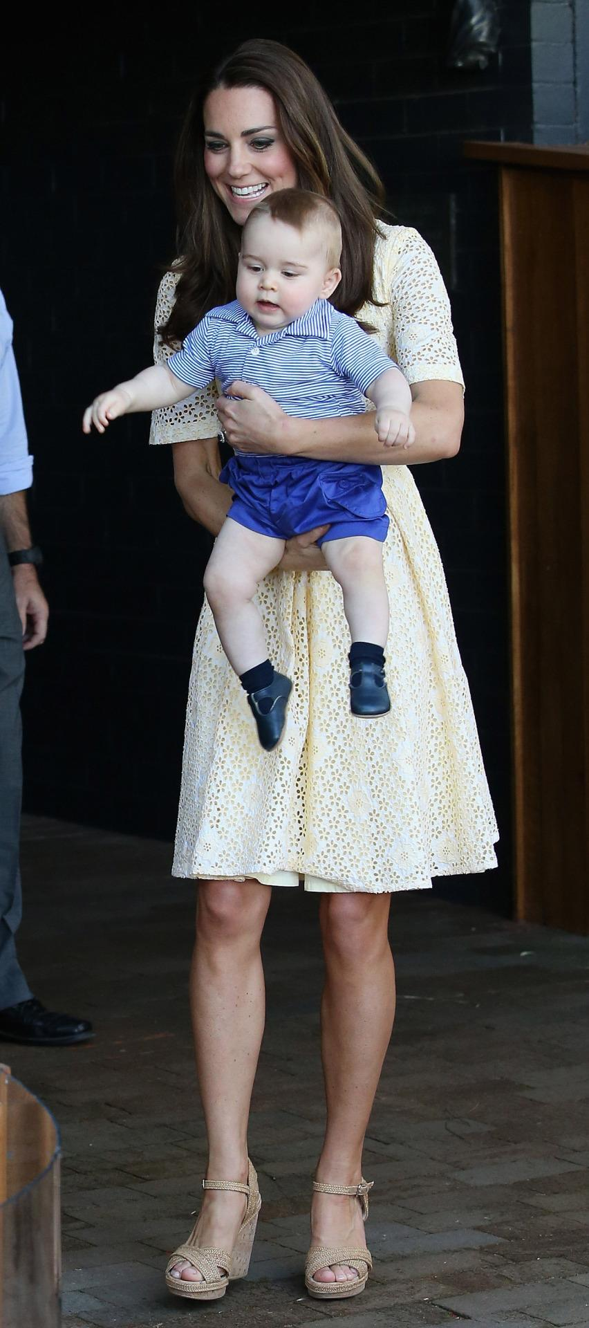<p>Kate and William took Prince George to a zoo in Australia with the Duchess donning a yellow broderie anglaise dress and Stuart Weitzman cork wedges. </p><p><i>[Photo: PA]</i></p>