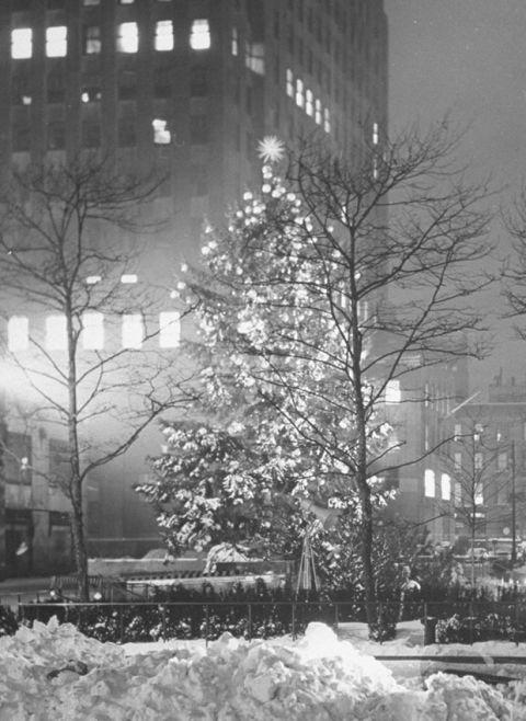 "<p>After four years of keeping the trees dark because of black-out regulations during World War II, the tree was glowing once again in 1945. During the ""dark years,"" the center had three trees decorated with painted wooden stars and unlit red, white and blue globes.  </p><p><a rel=""nofollow"" href=""http://www.goodhousekeeping.com/holidays/christmas-ideas/g2725/christmas-games/""><em>27 Christmas Games Your Whole Family Will Love  »</em></a><span><a rel=""nofollow"" href=""http://www.goodhousekeeping.com/holidays/christmas-ideas/a41823/hang-christmas-lights-vertically/""></a></span></p>"