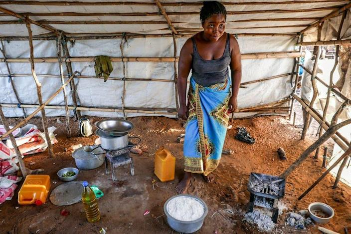 A woman prepares a meal with rice, aid from Caritas Mozambique, for a family with 30 displaced people, in Pemba, Mozambique, 30 March 2021 (issued on 01 April 2021).
