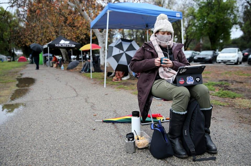 "<div class=""inline-image__title"">1299353966</div> <div class=""inline-image__caption""><p>Teacher Lily Gottlieb waits in a socially distanced standby line for people hoping to receive leftover COVID-19 vaccine doses in Encino, California. </p></div> <div class=""inline-image__credit"">Mario Tama/Getty</div>"